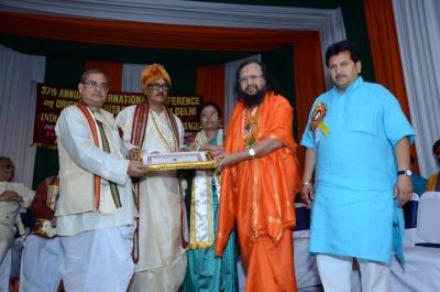 PhD and Mahamahopadhyay Award to Dr Pavitranandaji on 7 March in New Delhi (9).jpg